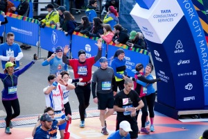 Chief Petty Officer Noah Bray from Coast Guard Sector New York crosses the finish line at the 2014 TCS New York City Marathon, Nov. 2, 2014. (U.S. Coast Guard photo by Petty Officer 3rd Class Frank Iannazzo-Simmons.)