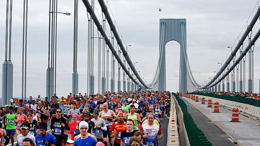 Runners cross the Verrazano-Narrows Bridge at the start of the New York City Marathon, Sunday, Nov. 1, 2015, in New York. (AP Photo/Jason DeCrow)